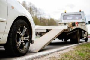 Tow Truck Loading Broken Car on Roadside | Marietta Wrecker Service