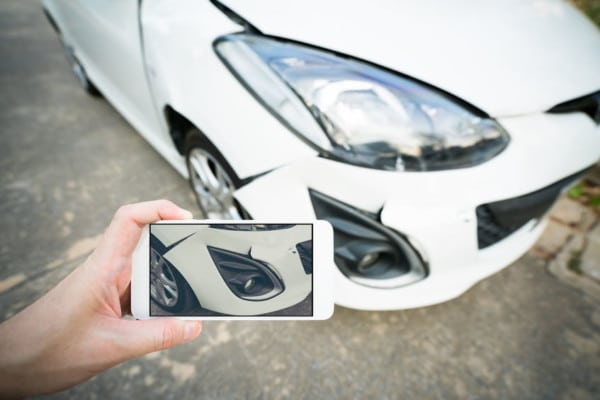 Taking Photo of Wrecked Car | Marietta Wrecker Service
