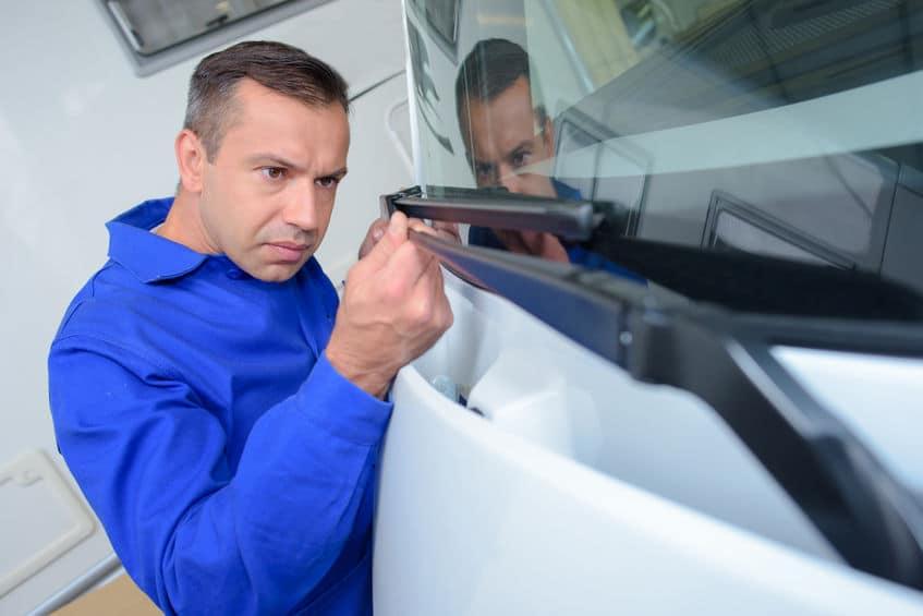 Man Replacing Windshield Wipers | Marietta Wrecker Service
